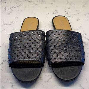 Franco Sarto black leather flats.   9.5
